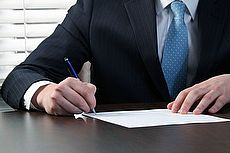 businessman sign agreement
